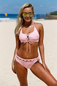 Pink two-piece, halter neck bralette top and moderate coverage bottom bikini set