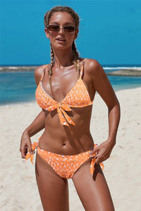 Orange two-piece, halter neck bralette top and moderate coverage bottom bikini
