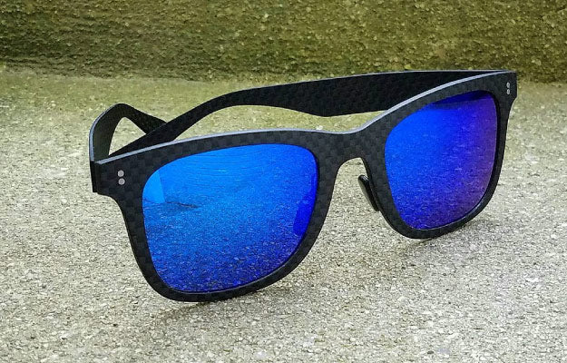 A pair of carbon fiber sunglasses | 7 Reasons Why People Love Our Carbon Fiber Sunglasses  | Visual Appearance And Aesthetics