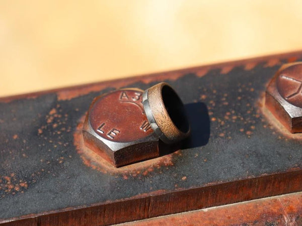 Craftsman Carbon Fiber & Walnut Wood 70/30 Ring by Element Ring Co. - lifestyle on plant