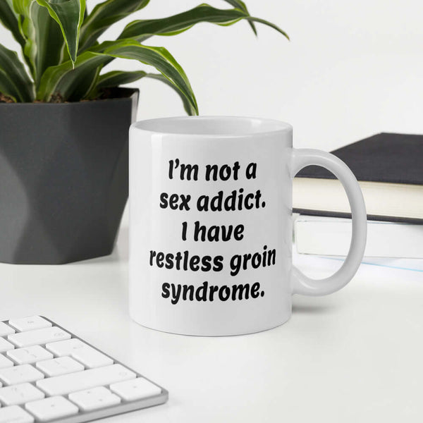 I'm not a sex addict funny restless groin syndrome mug