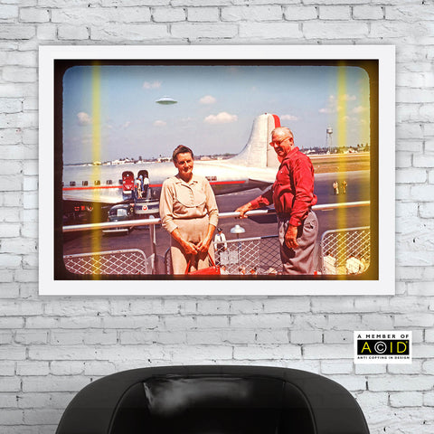 mid century photogaph retired american couple at airport with plane and UFO in background archival art print