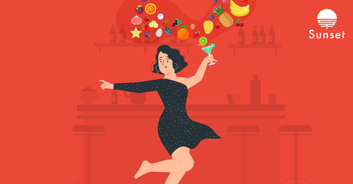 Woman dancing with a healthy alcoholic beverage