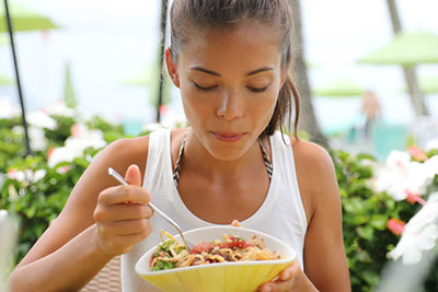 asian girl eating salad