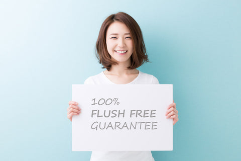 Asian girl holding guarantee sign