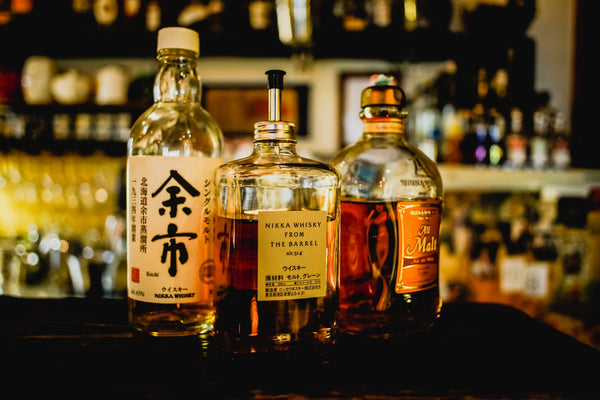 Whiskey bottles - source of asian glow