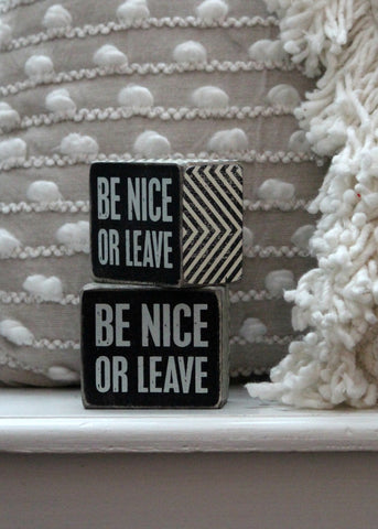 be nice or leave box sign