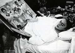 Frida Kahlo painting in bed