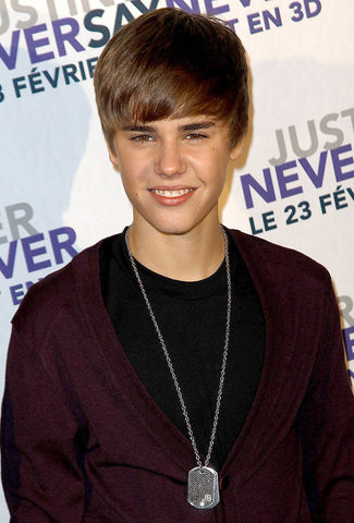 Justin Bieber wearing dog tag necklace