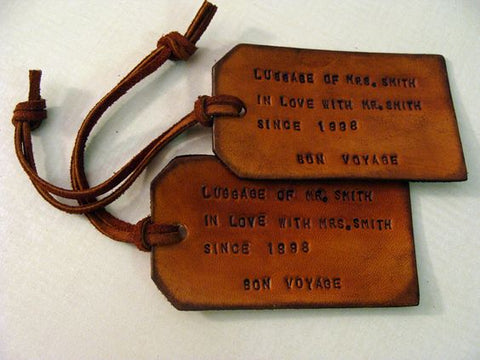 leather traveling tags