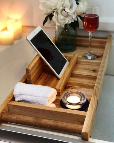 wooden caddy on bathtub