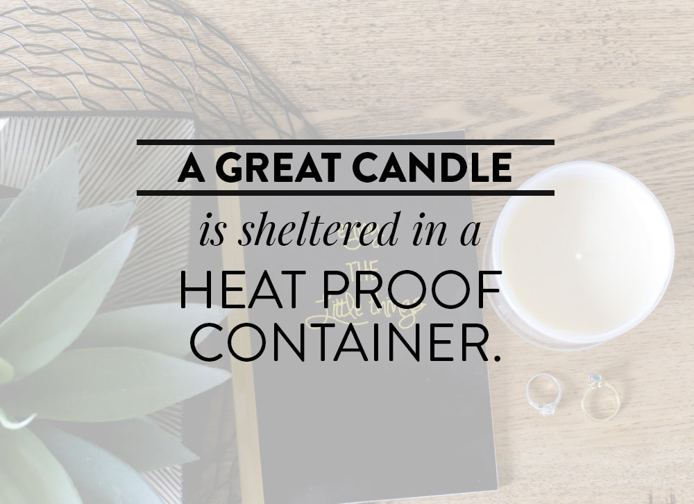 A great candle is sheltered in a heatproof container.