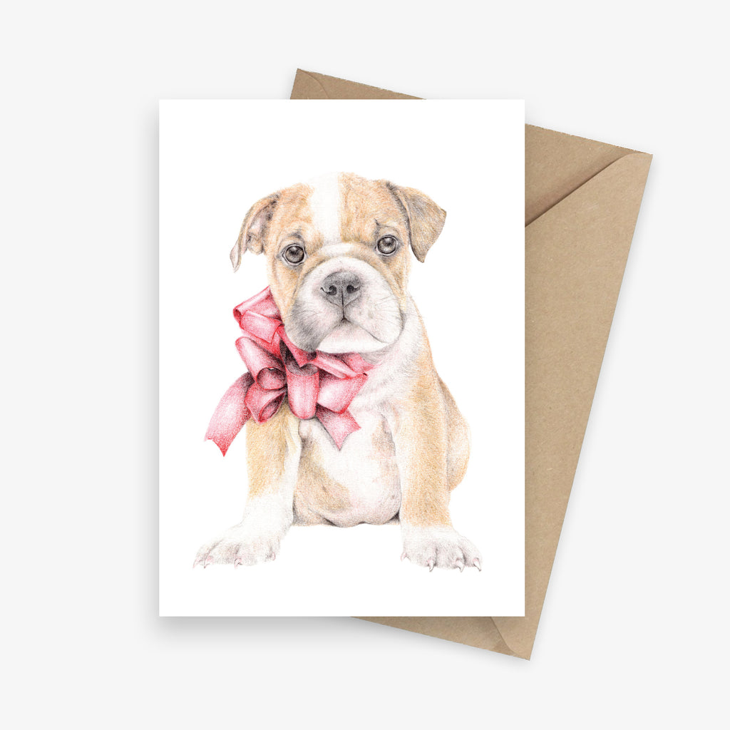 Illustrated greeting card featuring a British Bulldog puppy with a big red bow.