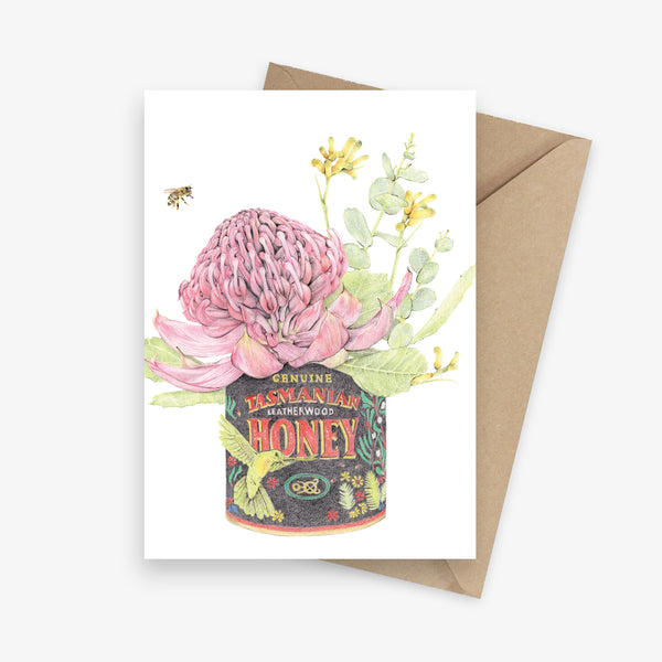 Greeting card with Australian native flowers featuring a waratah and kangaroo paws in a Tasmanian honey tin.
