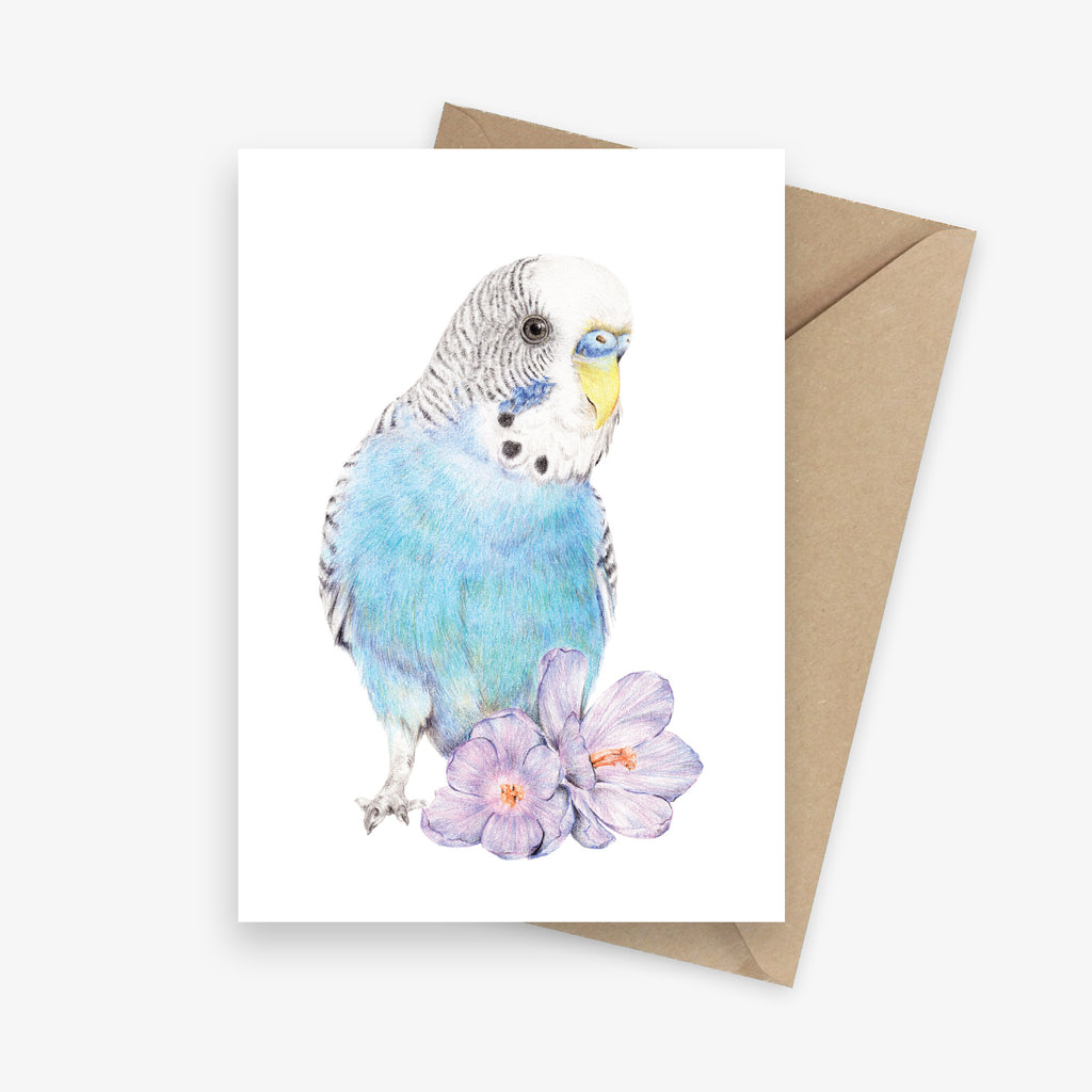 Greeting card featuring a blue budgie with two flowers.