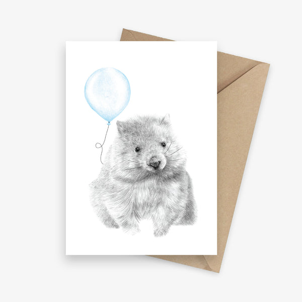 Birthday card featuring an Australian native wombat holding a blue balloon.