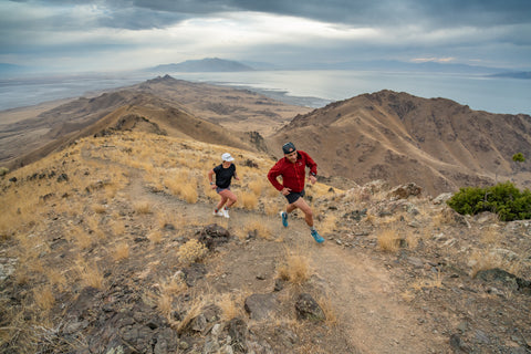 Couple running in the mountains together
