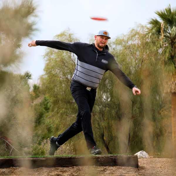 Disc golf is a very accessible sport: almost all courses are free to play. Pictured is a disc golf player throwing a disc.
