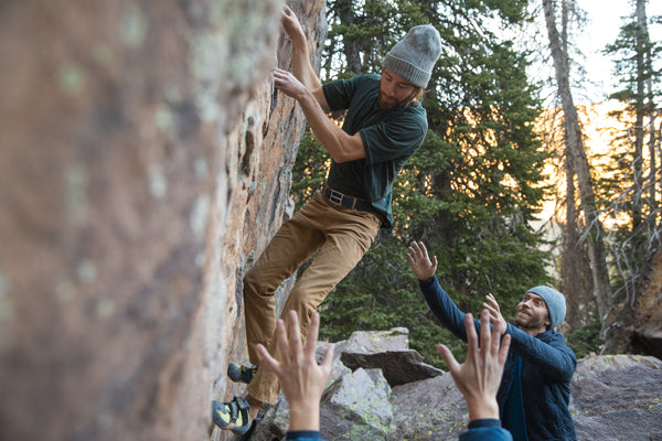 A climber starts on a new problem, wearing his ultralight belt for best performance.