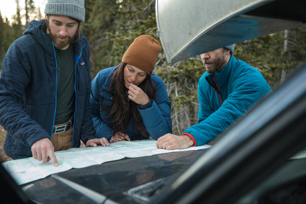 Hikers plan their next excursion, wearing their ultralight belts from GRIP6.