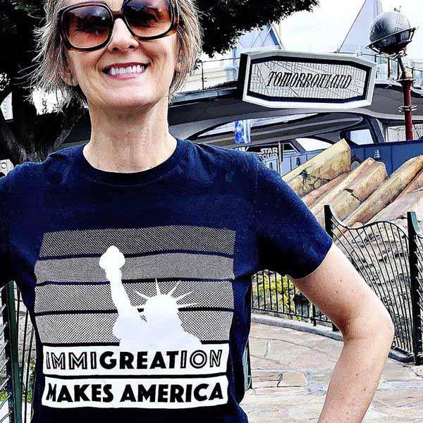 Immigration Women's T-shirt supporting RAICES navy model