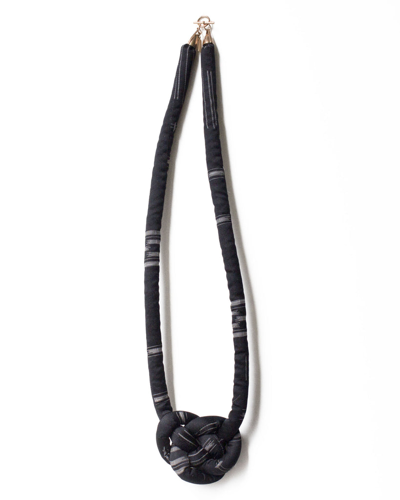 handmade knotted necklace with brass closure. Black and white ikat silk from a vintage kimono.