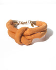 handmade double layer knotted bracelet with brass closure. Orange silk.