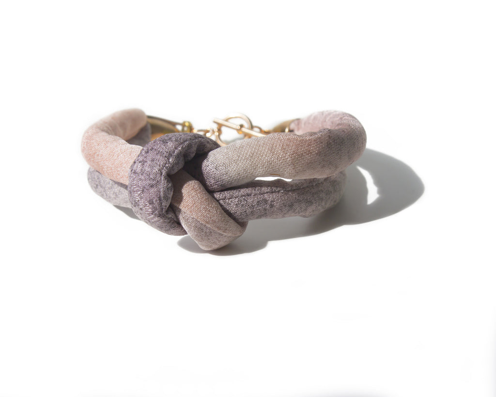 handmade double layer knotted bracelet with brass closure. purple and pink ombre silk from a vintage kimono.