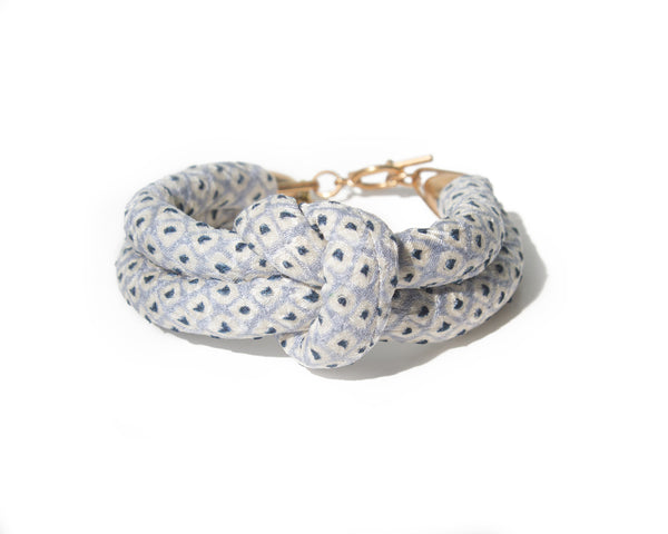 handmade double layer knotted bracelet with brass closure. light blue and white shibori dot silk from a vintage kimono.