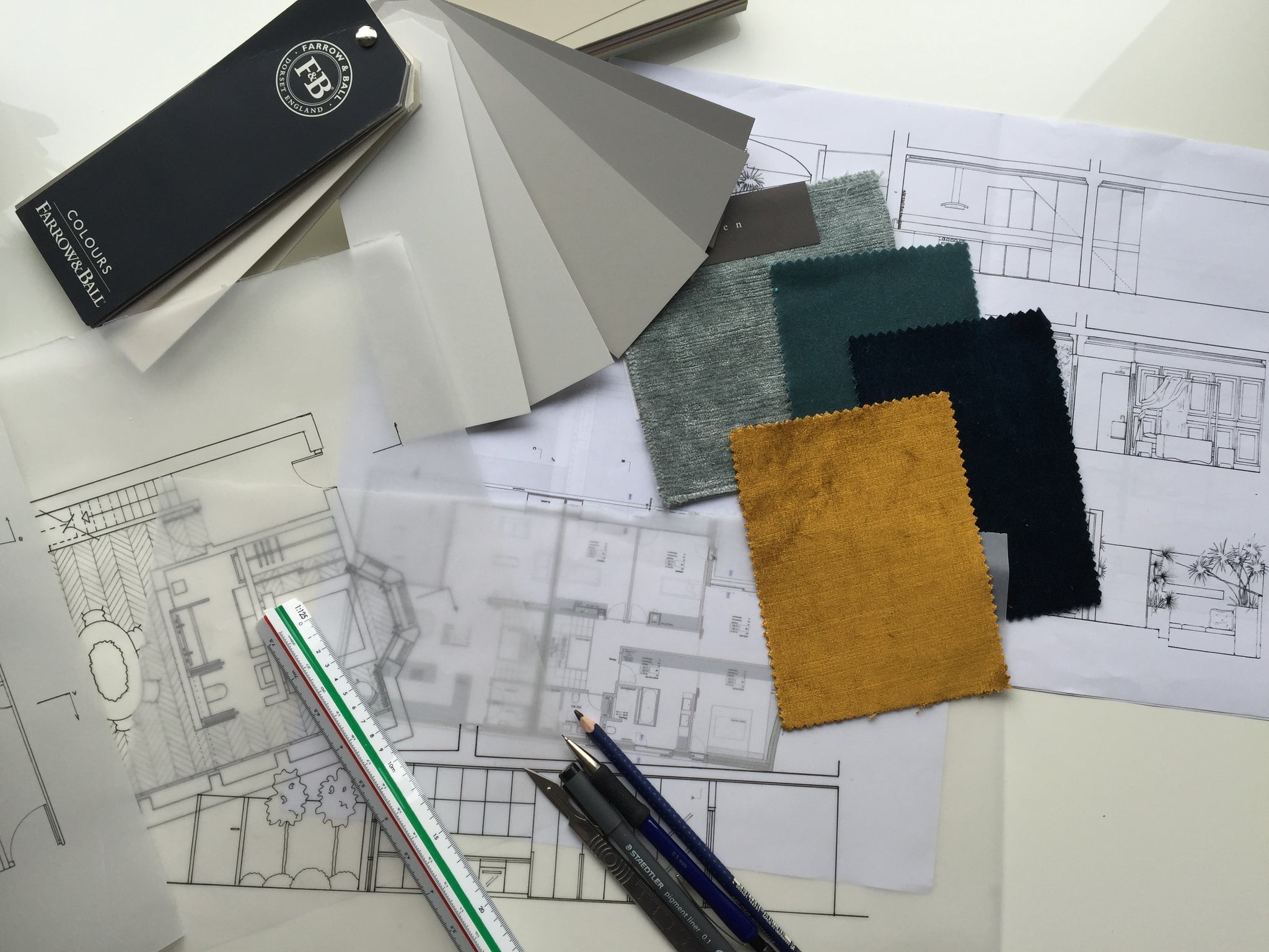 Working instruments of an interior designer, floor plans, fabric samples