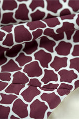 Detail of high waisted bikini bottoms in dark red burgundy giraffe animal print by Caroline af Rosenborg