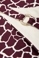 Detail on ring bikini bottoms in burgundy red bikini by Caroline af Rosenborg