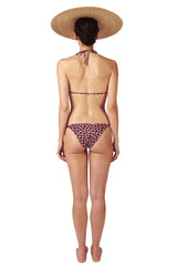 Front tie triangle top and side tie bottoms in burgundy red giraffe print by Caroline af Rosenborg