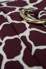 Detail of bandeau bikini top in burgundy red giraffe print with boning by Caroline af Rosenborg