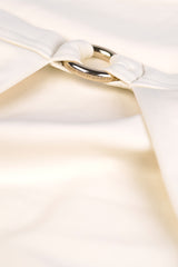 Front detail shot of front opening halter neck bikini top in cream white by Caroline af Rosenborg