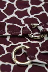 Detail image of cross back ring detail bikini top in burgundy red by Caroline af Rosenborg