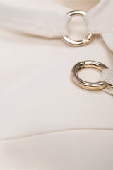 Ring lock detail of padded cross back ring detail bikini top in cream white by Caroline af Rosenborg