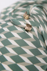 Cube detail from front tie triangle bikini top in sage green cream ivory white diamond print by Caroline af Rosenborg