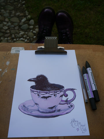 Photo of crow in teacup drawing