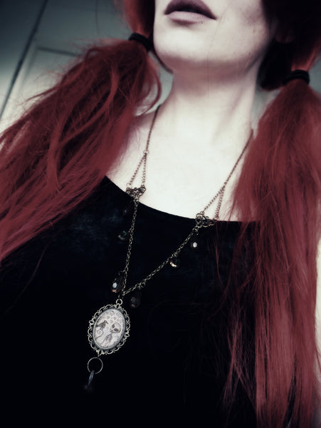 Modelled image of Alien and Crow charm necklace