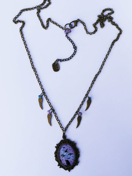 Full view of conspiracy raven charm necklace