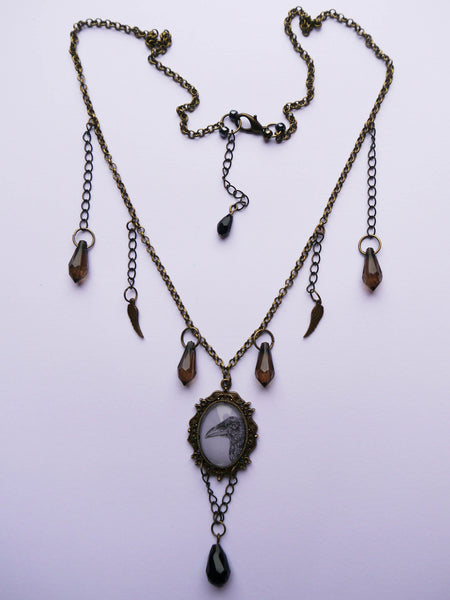 Full view of 'Baby Crow' charm necklace