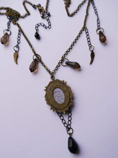 Rear view of hand signed baby crow antique necklace