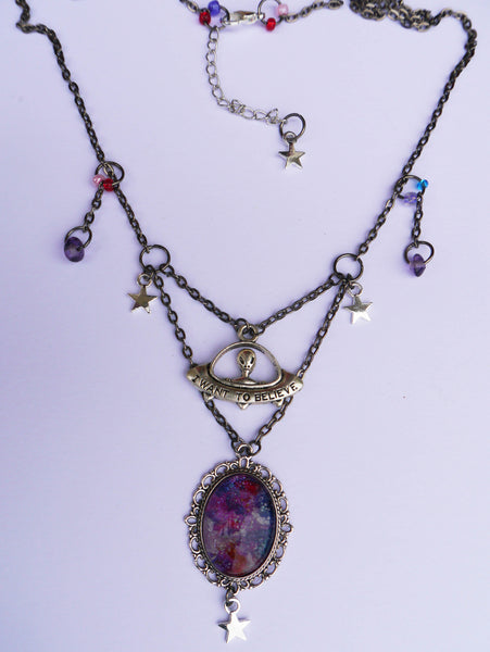 full view of galaxy painting necklace