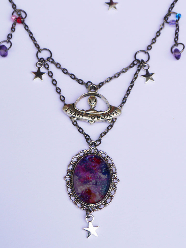 close up view of spaced out charm necklace
