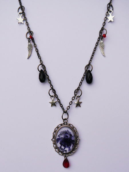 Photo of charms on 'little' crow necklace