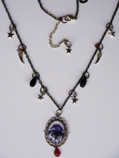 Full view of crow chick necklace