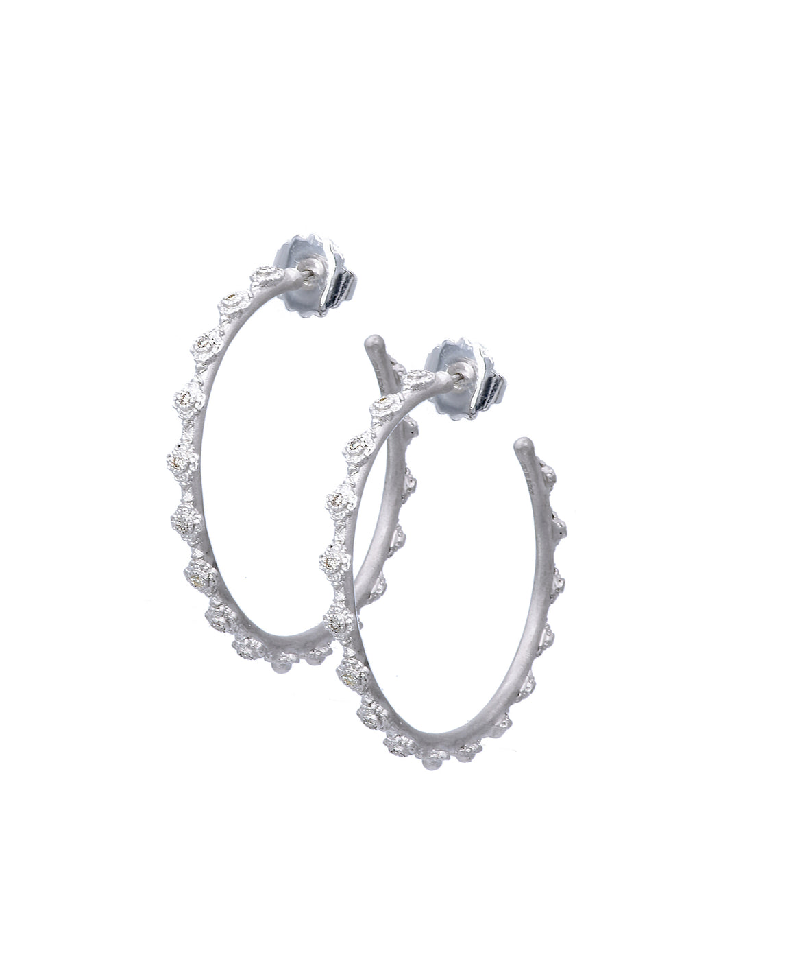 Cravelli crosses line these textured sterling silver hoop earrings. The earrings are set in front with champagne diamonds. The hoops are 35 mm in diameter.