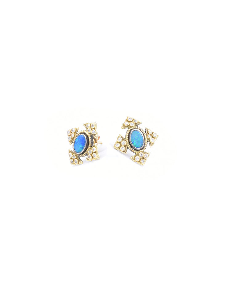 "Vibrant boulder opals are the centerpieces of these stud earrings. The 18k yellow gold and sterling silver studs are about 5/8"" tall."