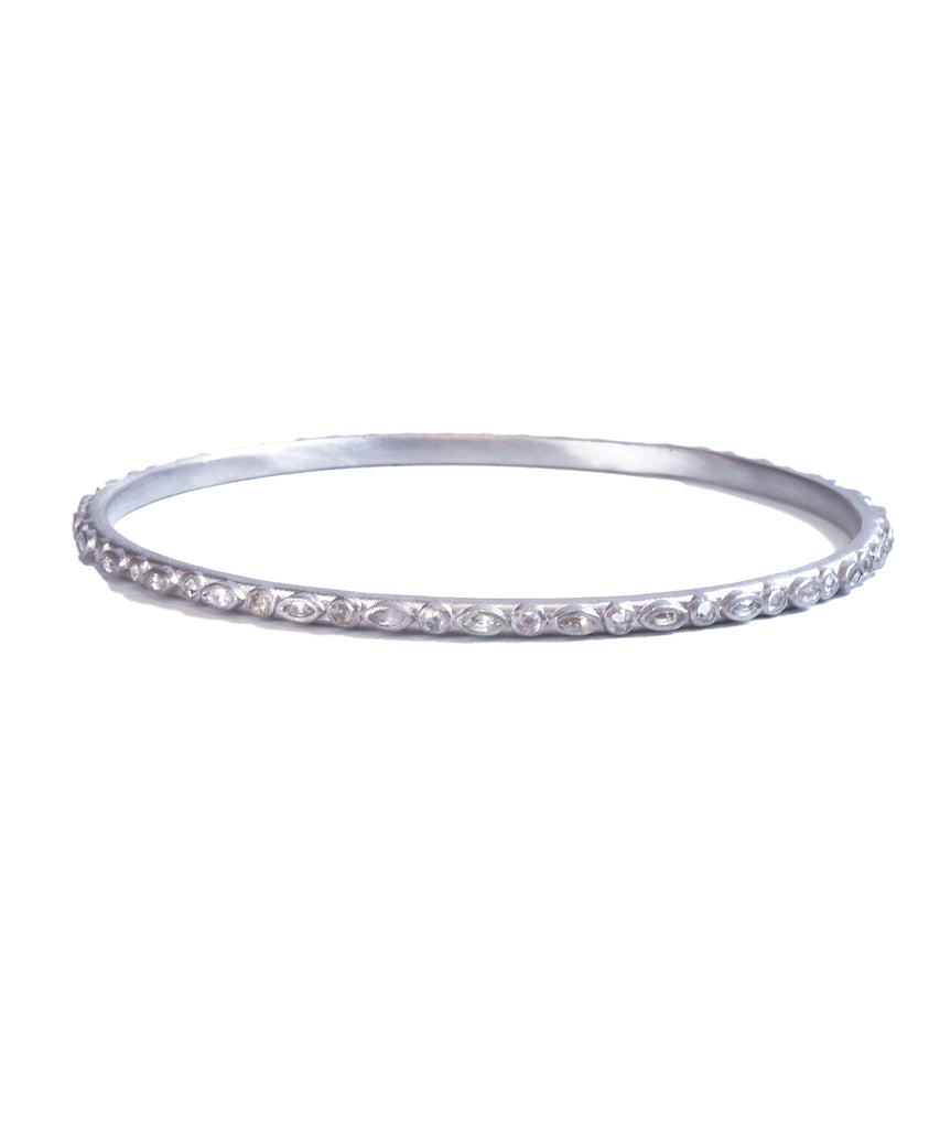 "Alternating marquis and round shapes are set with white sapphires and diamonds in this sterling silver New World bangle. It's about 2 1/2"" in diameter inside."